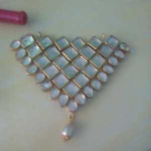 Triangle kundan pendant