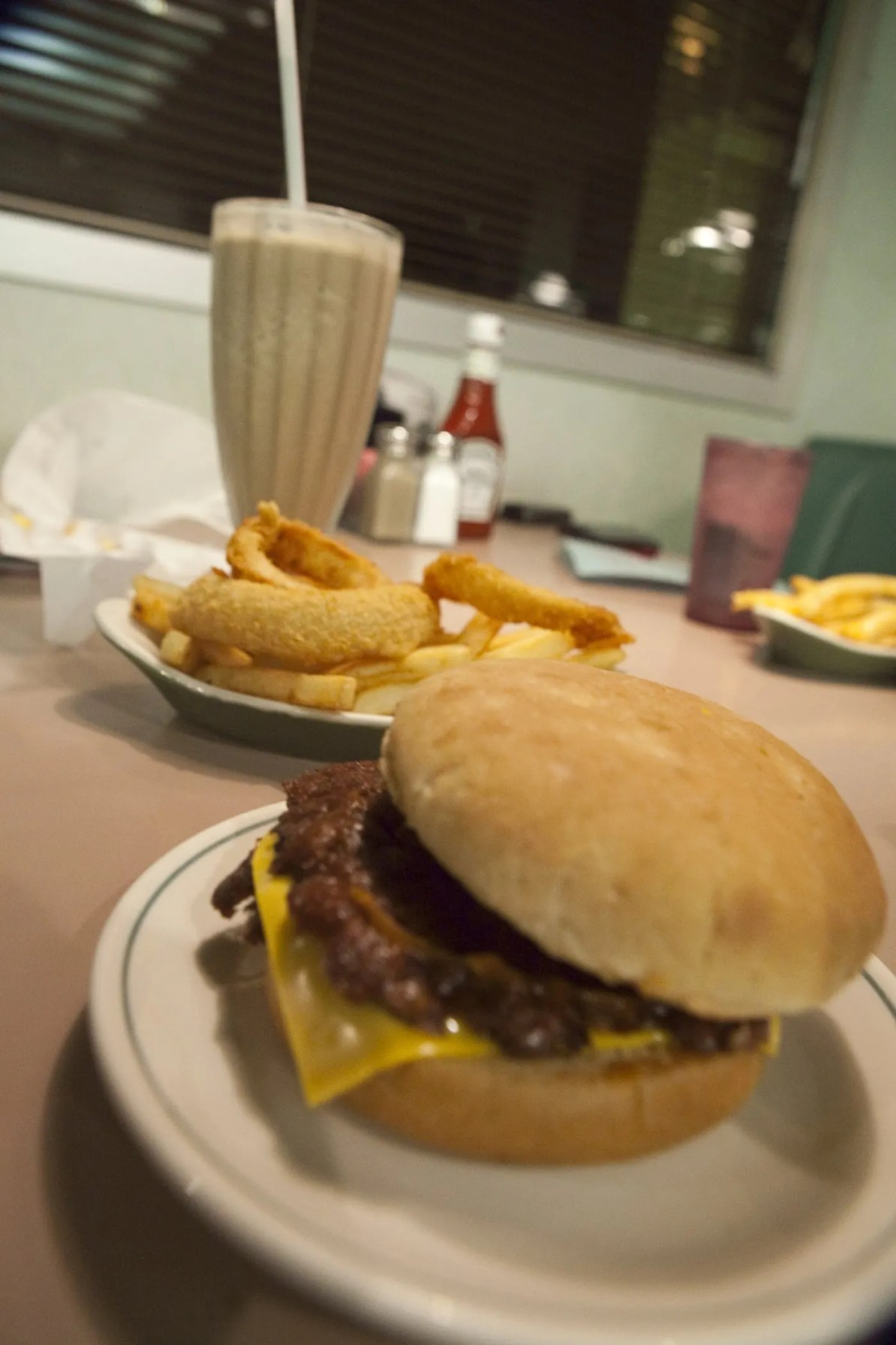 Double hamburger with cheese, a 50/50 of fries and onion rings, and a chocolate milkshake at Winstead's in Overland Park, Kansas.