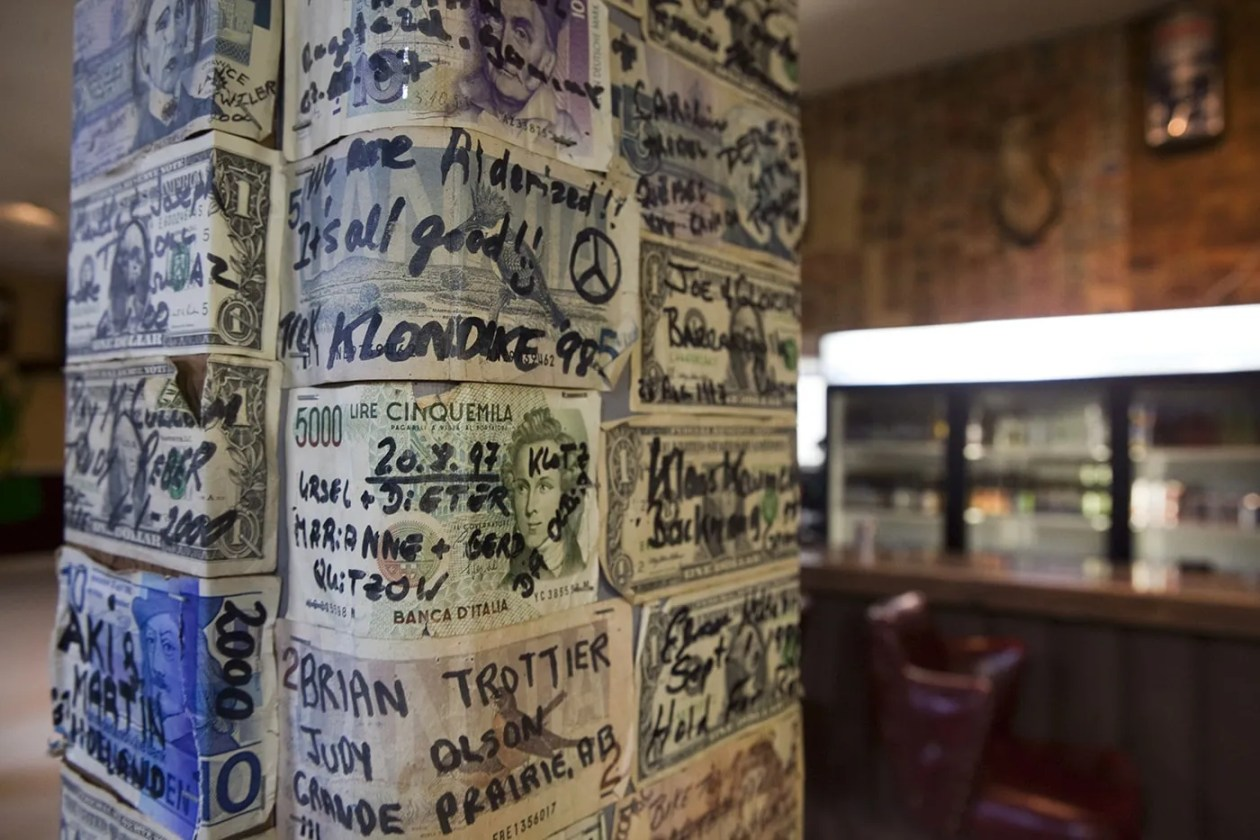 Signed dollars from all over the world line the walls of the Glacier Inn in Hyder, Alaska.