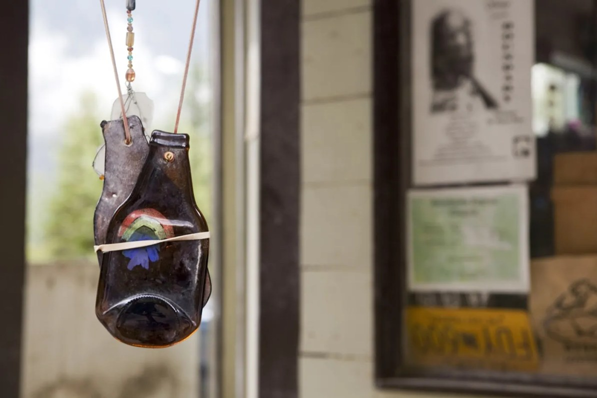 Hanging bottle wind chimes on the porch of a fudge shop in Hyder, Alaska.