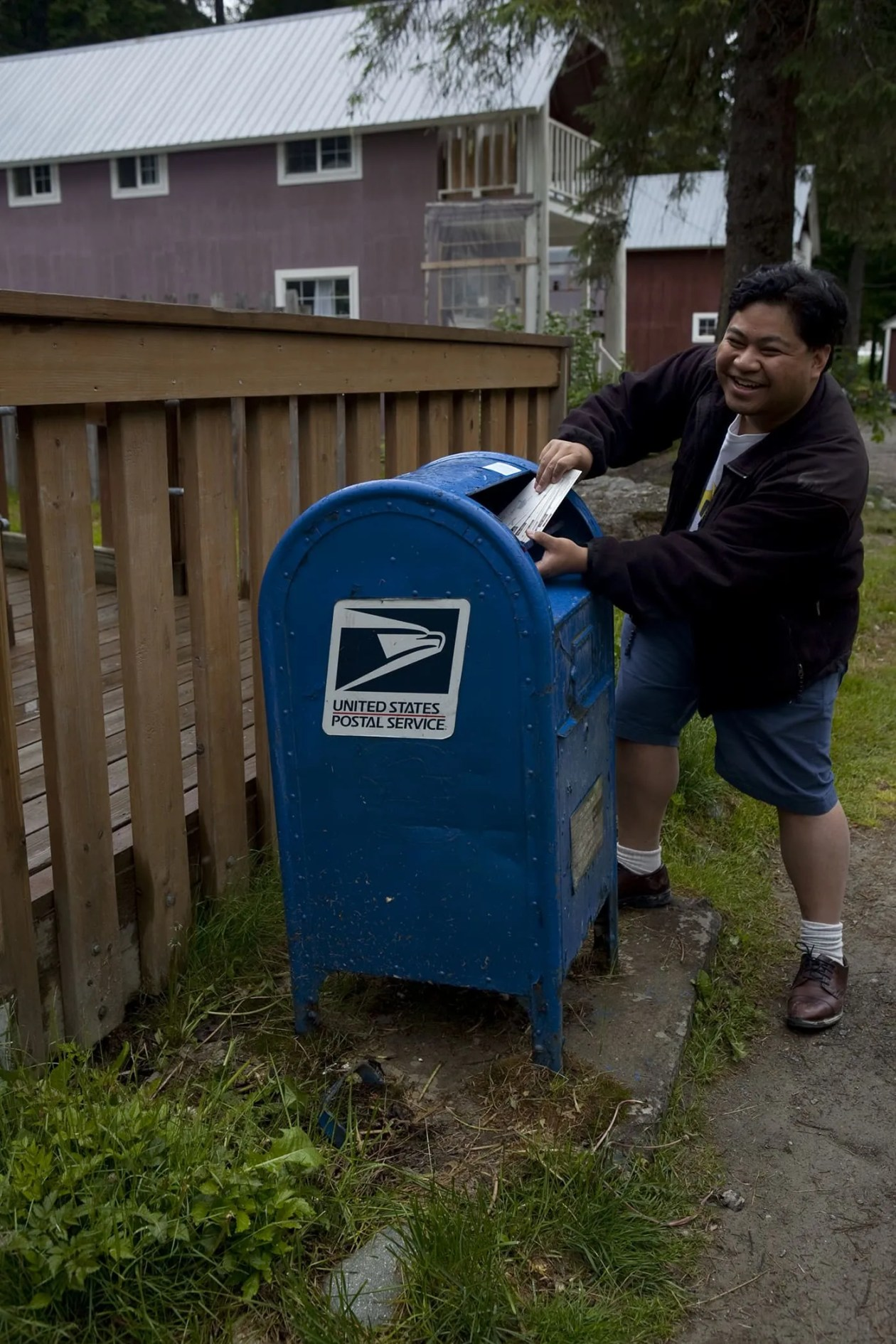 Mailing postcards at the Hyder, Alaska Post Office.