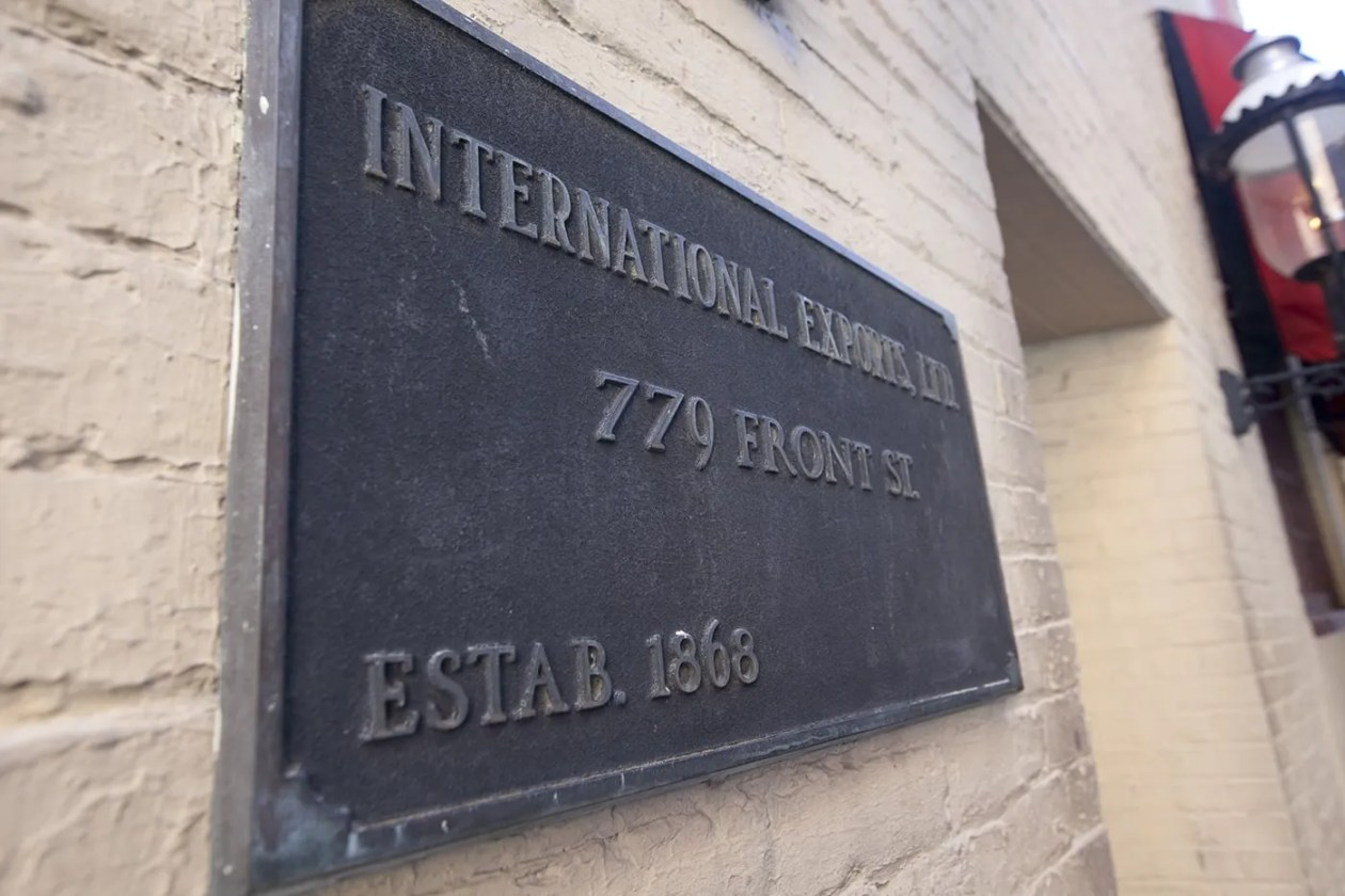 International Exports Ltd sign outside of the Safe House, a spy-themed restaurant in Milwaukee, Wisconsin.