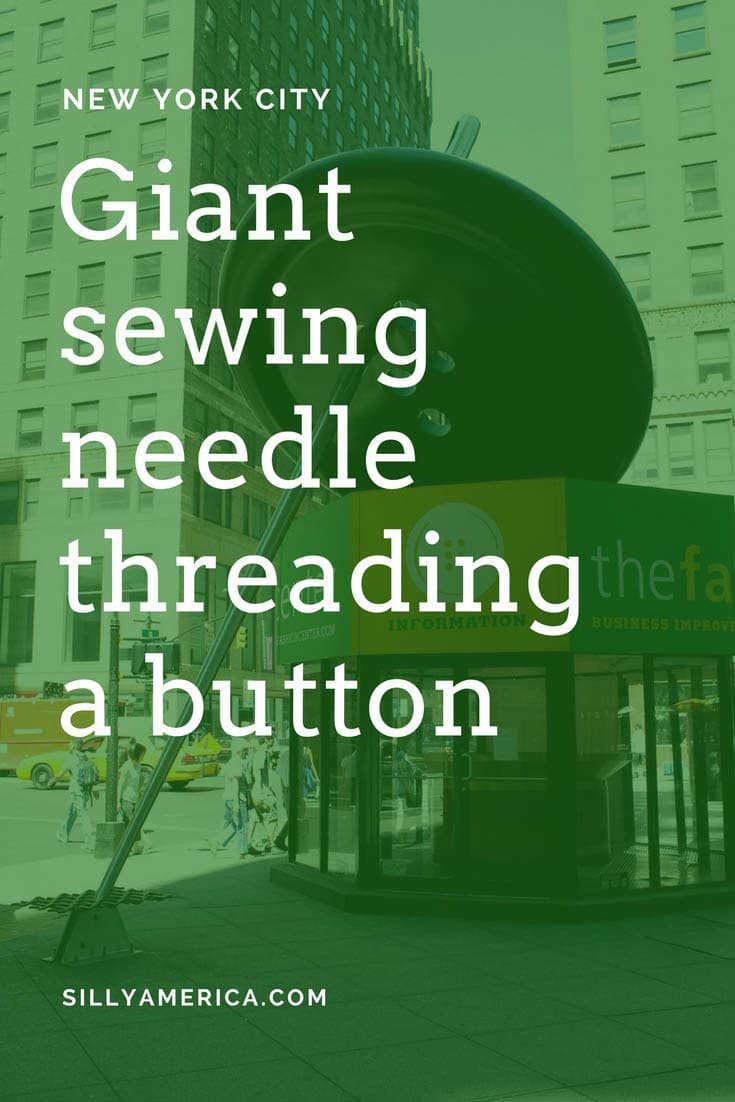 Giant sewing needle threading a button in New York City's Fashion District.
