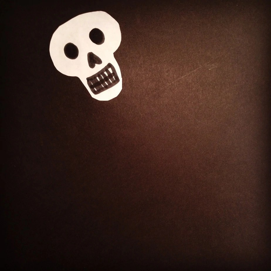 Cut The White Paper Into A Skull Shape And Stick On The
