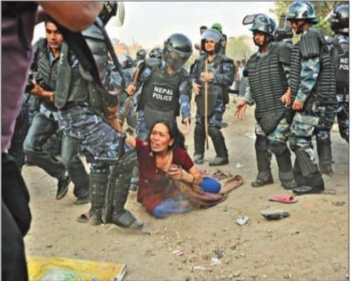 woman-resisting-bagmati-evacuation-being-dragged-by-police