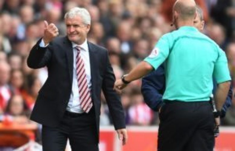 Mark Hughes being sent to the stands by referee Anthony Taylor on Saturday.