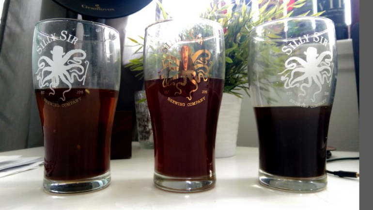 """Left: melted ice that was freshly skimmed off the top. Middle: melted ice taken from the brew kettle. Right: the concentrated """"eisbock"""""""