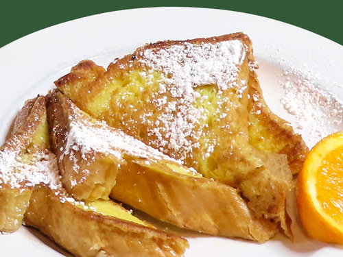 Photo of french toast dusted with sugar