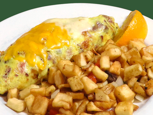 Photo of Meat Lover's Omelette served with potatoes