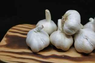 garlic bulbs on brown surface