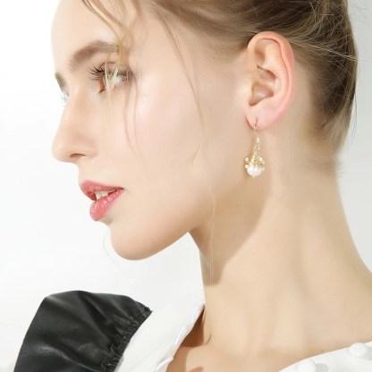 Pearl Dangle Drop Earrings Modeled