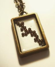Copper and resin in a rectangular Pendants with a plated iron in bronze chain. £12 +post and packaging.