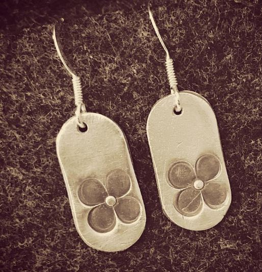 Fine silver earrings with flower impression and a sterling silver earring hook. £14 + post and packaging.