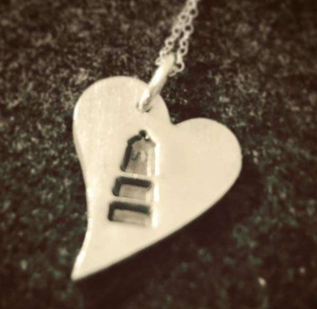 Heart shape fine silver pendant with a light house impression and a sterling silver chain. £20+ post and packaging.