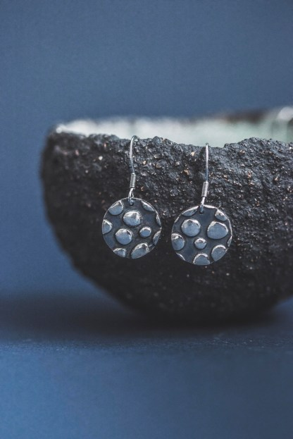 Dangle round fine silver earrings textured and decorated with oxidisation