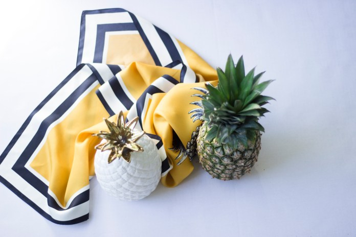 one ceramic pineapple, and one real pineapple.