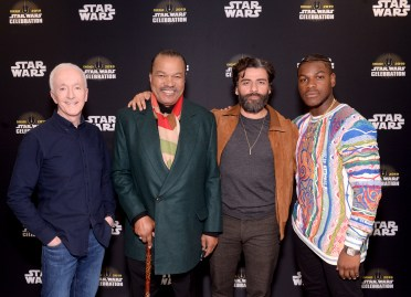 """CHICAGO, IL - APRIL 12: (L-R) Anthony Daniels (C-3PO), Billy Dee Williams (Lando Calrissian), Oscar Isaac (Poe Dameron) and John Boyega (Finn) attend """"The Rise of Skywalker"""" panel at the Star Wars Celebration at McCormick Place Convention Center on April 12, 2019 in Chicago, Illinois. (Photo by Daniel Boczarski/Getty Images for Disney ) *** Local Caption *** Anthony Daniels; Billy Dee Williams; Oscar Isaac; John Boyega"""