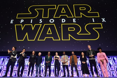 """CHICAGO, IL - APRIL 12: (L-R) Moderator Stephen Colbert, Director J.J. Abrams, Producer Kathleen Kennedy, Anthony Daniels (C-3PO), Billy Dee Williams (Lando Calrissian), Daisy Ridley (Rey), John Boyega (Finn), Oscar Isaac (Poe Dameron), Kelly Marie Tran (Rose Tico), Joonas Suotamo (Chewbacca) and Naomi Ackie (Jannah) onstage during """"The Rise of Skywalker"""" panel at the Star Wars Celebration at McCormick Place Convention Center on April 12, 2019 in Chicago, Illinois. (Photo by Daniel Boczarski/Getty Images for Disney ) *** Local Caption *** Stephen Colbert; J.J. Abrams; Kathleen Kennedy; Anthony Daniels; Billy Dee Williams; Daisy Ridley; John Boyega; Oscar Isaac; Kelly Marie Tran; Joonas Suotamo; Naomi Ackie"""