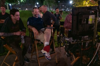 (from left) Pete Davidson and director Judd Apatow with crew members on the set of The King of Staten Island.