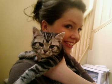 OP-Armani-American-Shorthair-silver-tabby-kitten-resting-on-womans-shoulder