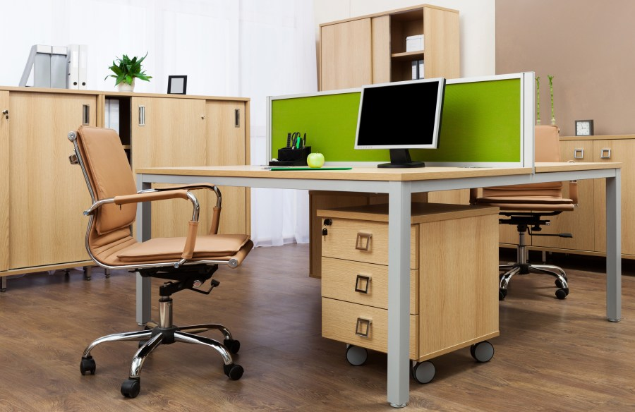 Ergonomic office desk and chair in a thoughtfully laid out setting.