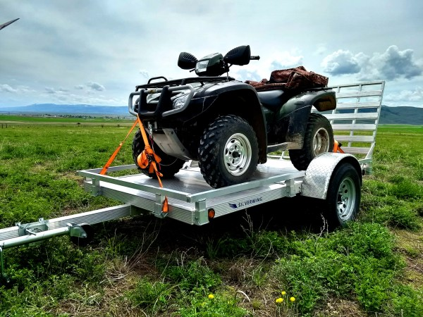 an ATV being towed using the trailer
