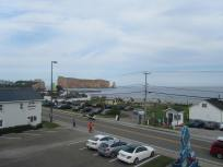 The monolith dwarfs the harbour