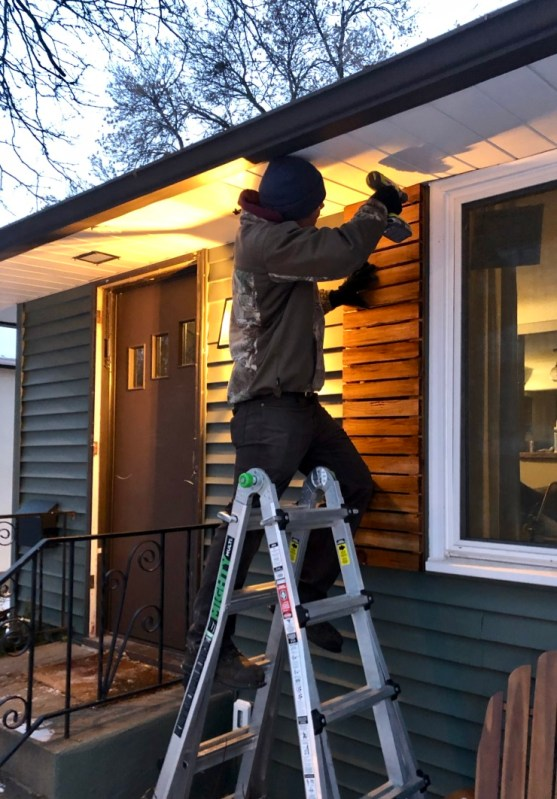 Josh installing the shutters.