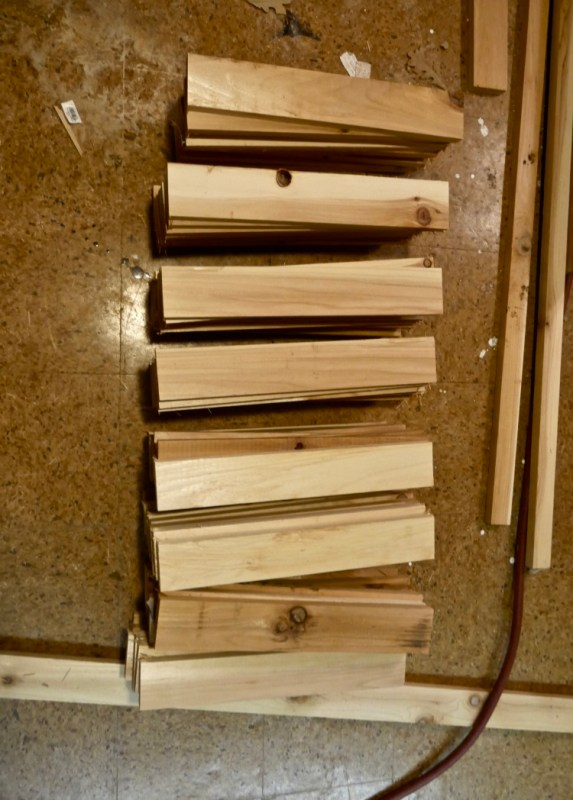 All of the horizontal shorter boards cut and ready to install- 50 in total.