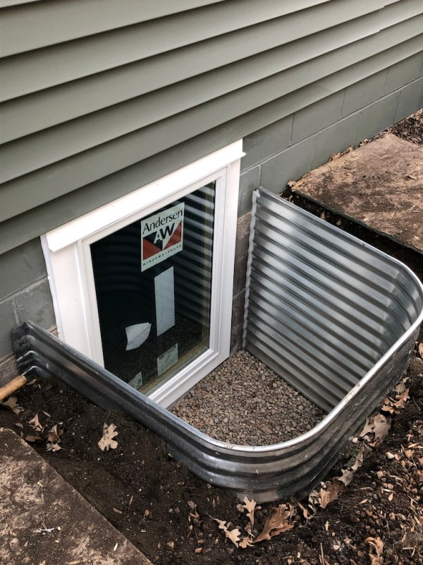 Egress window newly installed in the basement | Sima Spaces