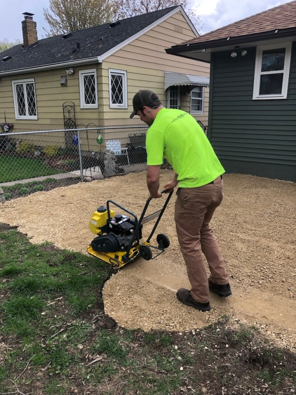 Sima Spaces patio remodel: tamping the gravel