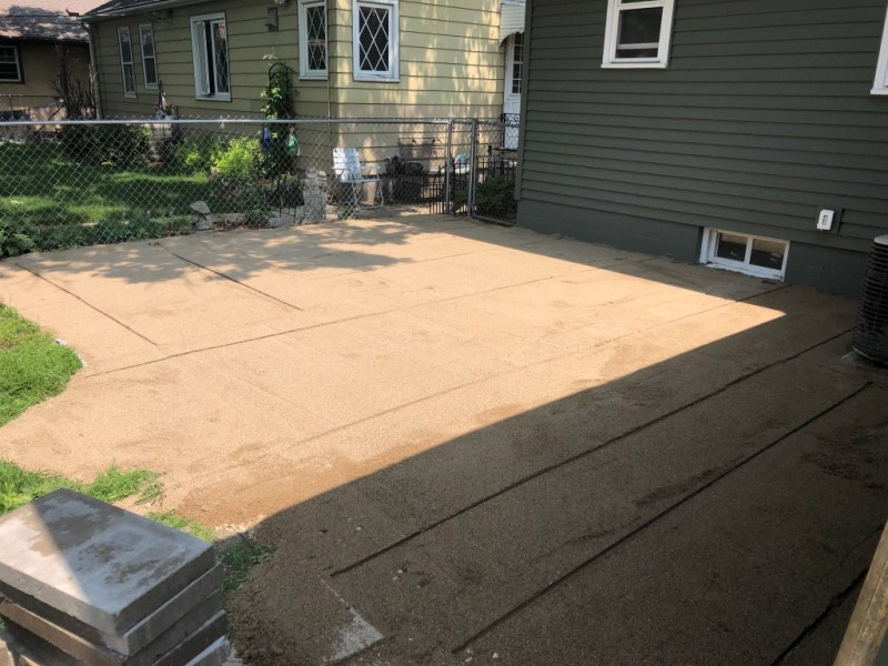 Sima Spaces patio remodel: paver sand install