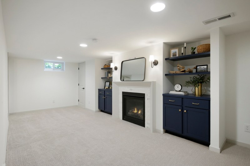 Basement builtin fireplace, basement remodel, Naval Builtin cabinets / Sima Spaces