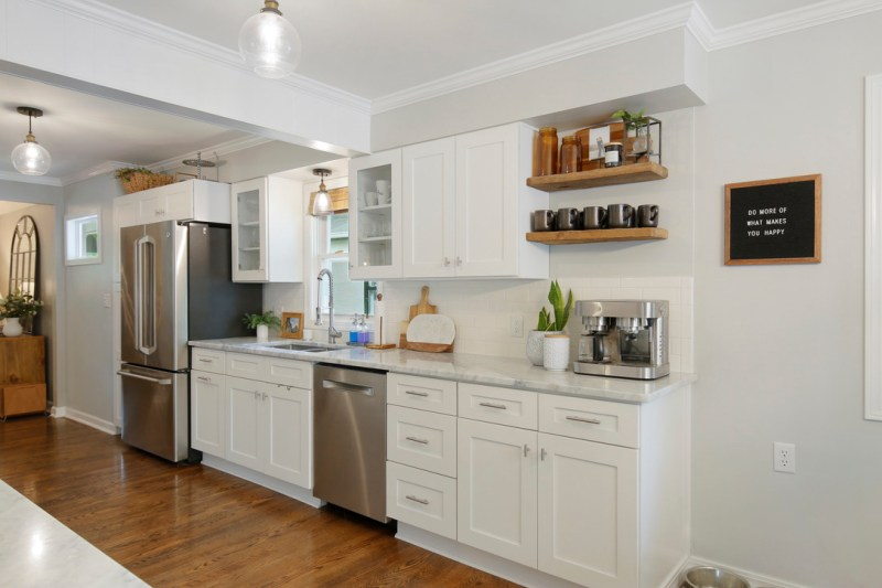 Remodeled 1950's kitchen, white cabinets, carrara marble countertops, subway tile backsplash, open shelving, open concept kitchen / Sima Spaces