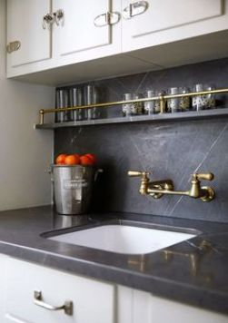 Soapstone countertops and backsplash via David Lucido // Sima Spaces Kitchen renovation