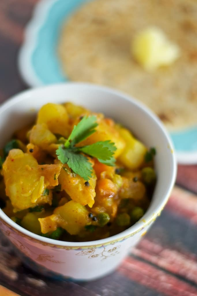 I love this recipe of Aloo Matar because it is easy to make, tasty and healthy - the perfect accompaniment to hot rotis!