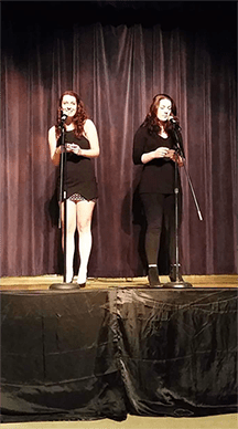 Two students perform together