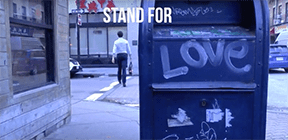 """A photo of Boston streets, including a mailbox with """"LOVE"""" painted on the side"""