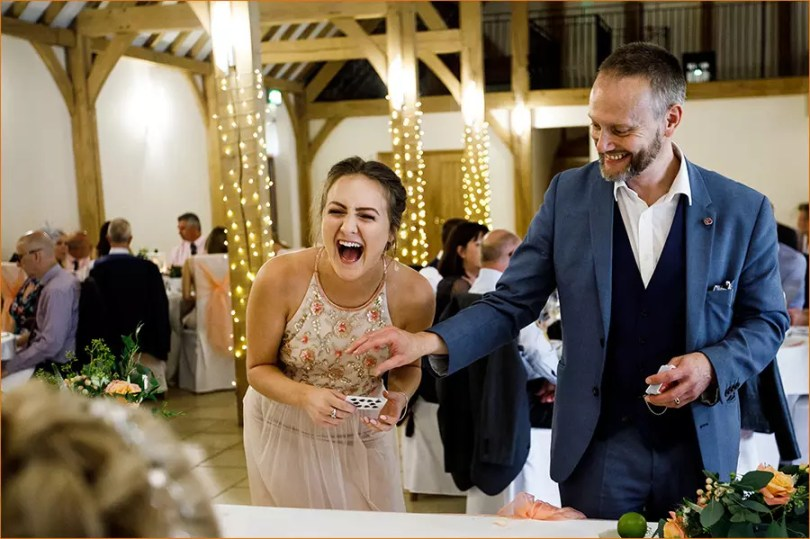 Hungerford Magician Performs Close-Up Magic to Laughing Young Lady