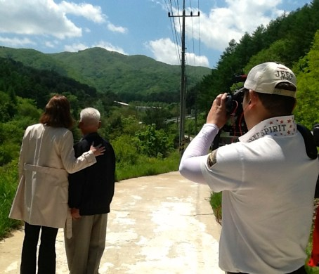 Filming at Maehwa-San Mountain where Vince Healy, the uncle of Passage to Pusan author Louise Evans, died in battle in March 1951. Louise was grateful to meet South Korean war veteran Choi Chang Sung, 87, (pictured) who fought in the same battle.