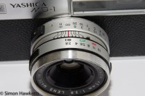 Yashica MG-1 - Lens showing aperture and focus adjustment