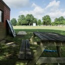 Ricoh GXR and P10 sample pictures - A picnic table by the score board shed
