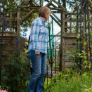 Garden pictures with Takumar standard lenses - A woman looks round an English country garden