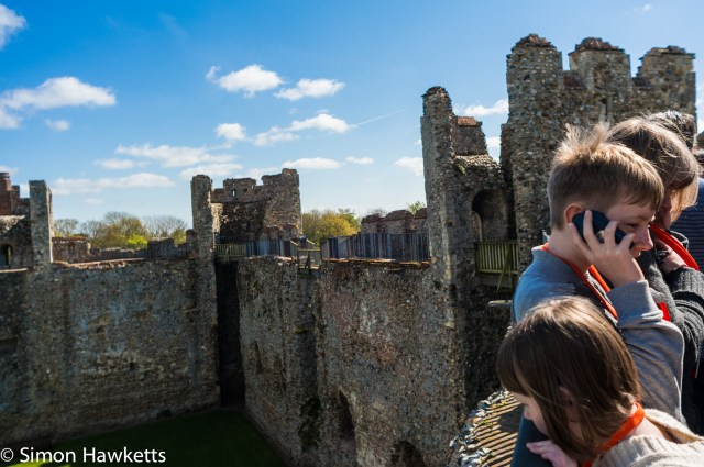 Pictures of Framlingham in Suffolk - Listening to the comentary on the battlements of Framlingham Castle