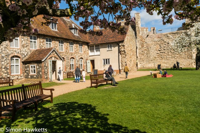 Pictures of Framlingham in Suffolk - Someone sitting on a seat in Framlingham Castle