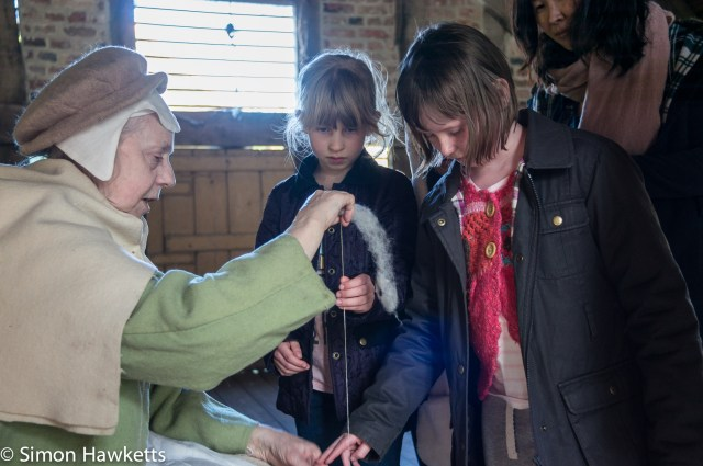 Kentwell Hall Tudor day pictures - Spinning some wool