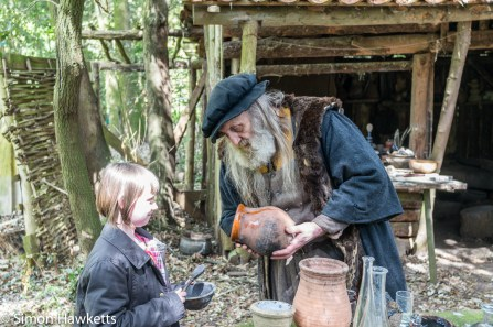 Kentwell Hall Tudor day pictures - The alchemist mixes the components of gun powder