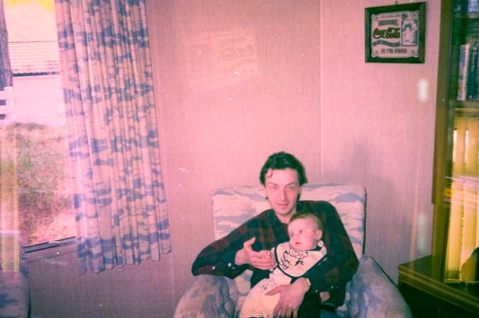 Photos from film found in old cameras - A man holding a baby