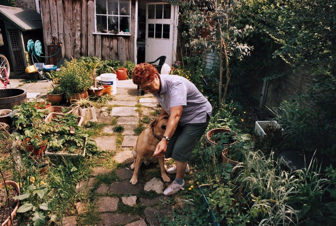 Photos from film found in old cameras - a woman playing with a dog in a garden