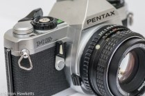 Pentax MG 35mm slr showing self timer and lens release